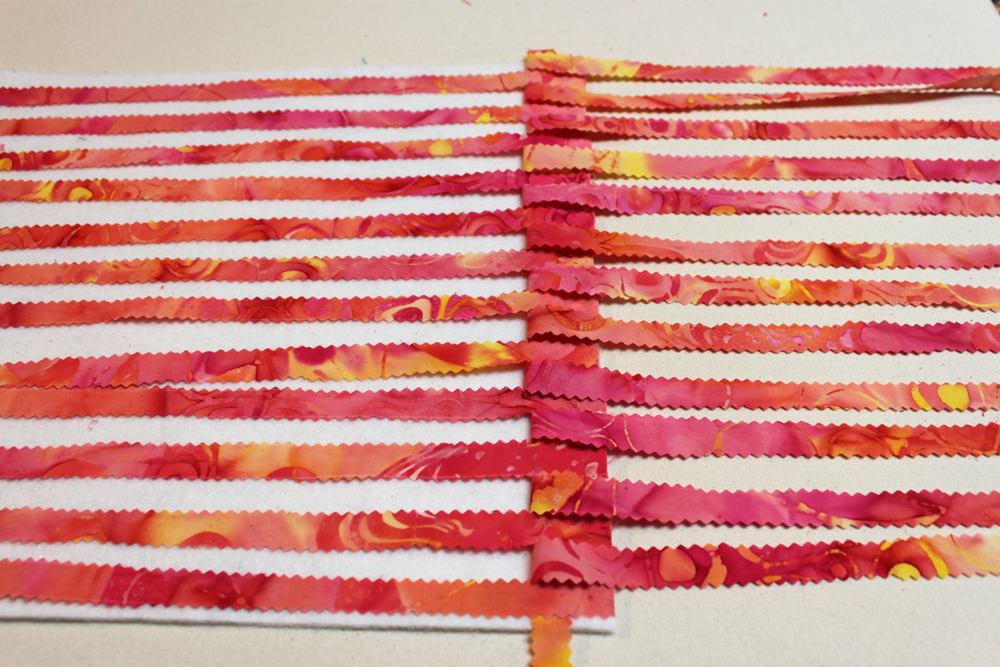 Replace the strips of warp fabric that you moved to the right.