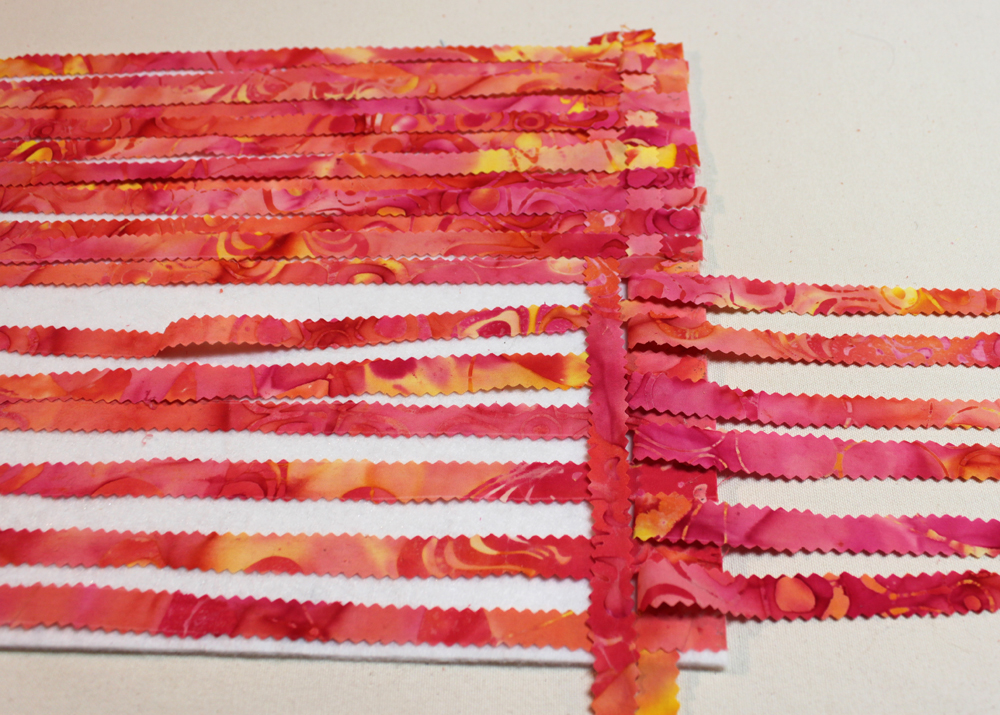 Place another weft strip vertically. Replace the warp strips. Alternate the warp strips that you peel to the right.