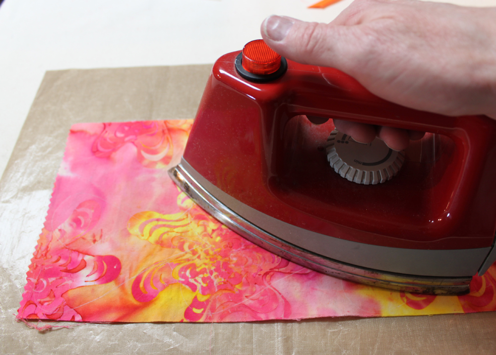 Adhere Misty Fuse to the back of one of your plain fabrics using a Teflon sheet to protect your ironing surface.