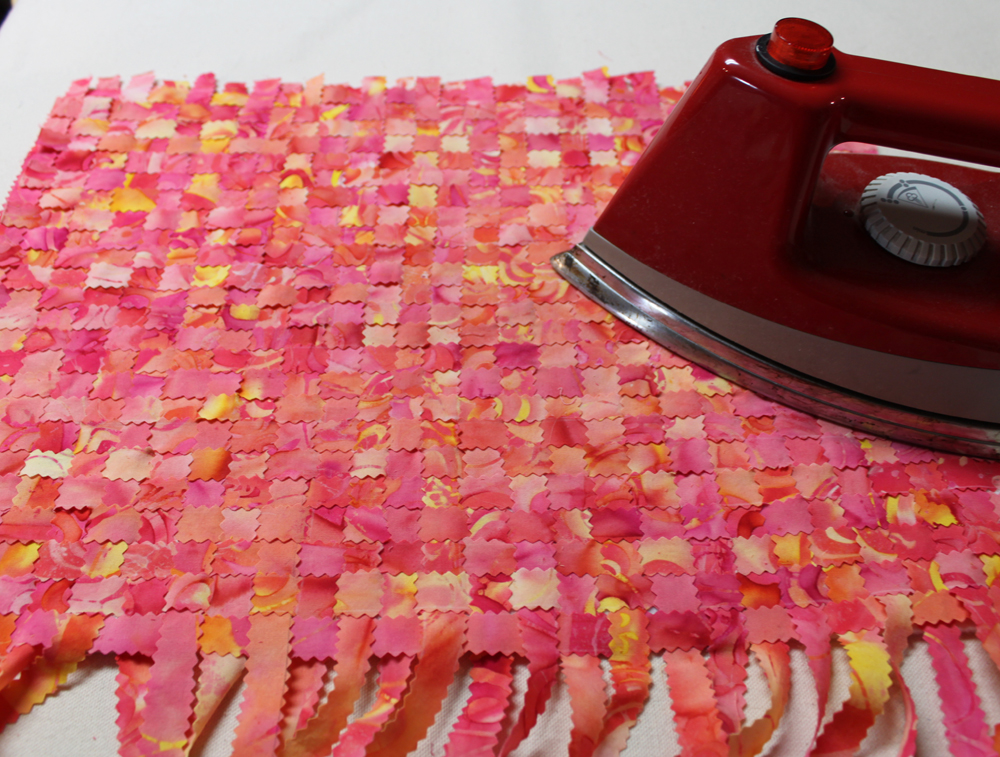 Use a hot iron to fuse the woven fabric to the felt.