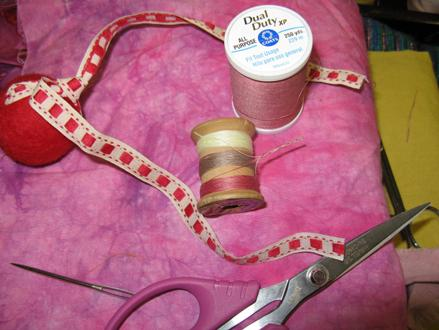 Wrap several colors of sewing thread around the spool. Twist the threads together by hand to keep them from raveling.
