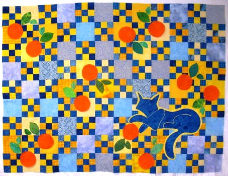 added blue cat and oranges to quilt