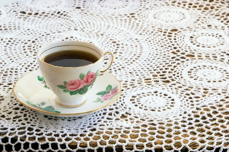 Vintage Teacup on Crochet Tablecloth