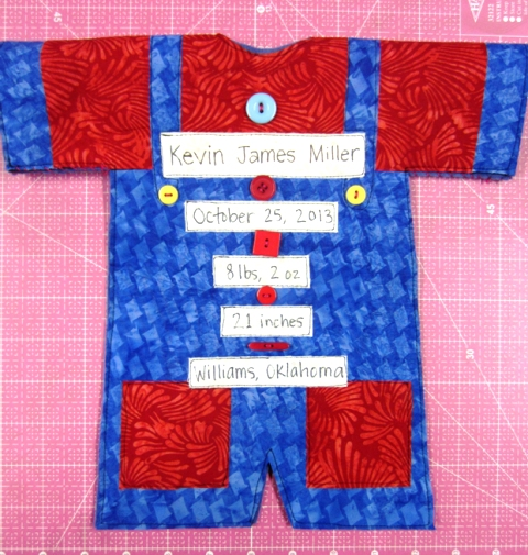 Hand sew on the buttons, from your collection.   I used a variety of funky buttons.  I used red Perle Cotton #8 thread.