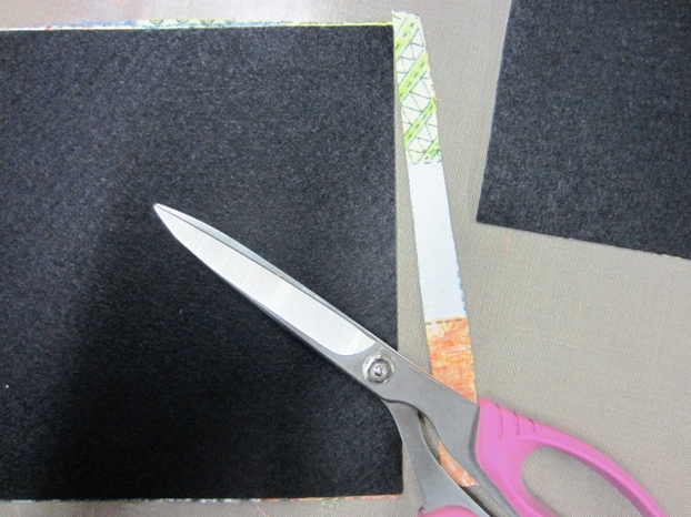 Trim the excess fabric off the edges, by turning it over and cut from the back, using the felt as your guide.