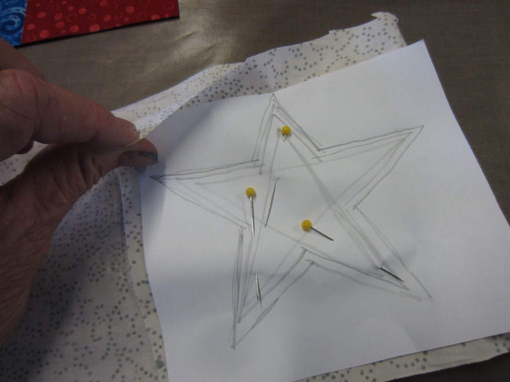 Pinning the star pattern to fabric