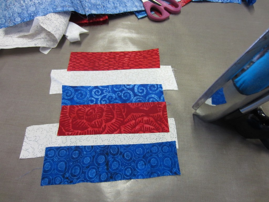 Fabric strips used for a summer flag craft project