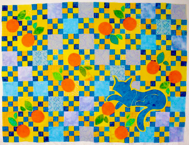 fused-applique-techniques-bluecat-with-oranges