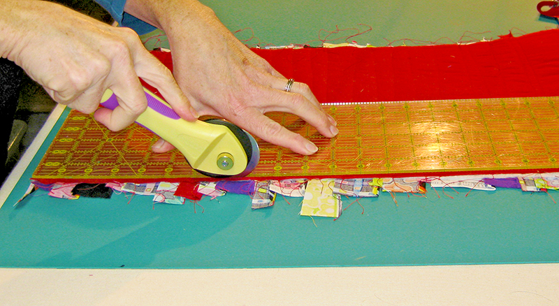 "Use the 60mm rotary cutter to trim the runner to the desired finished size (12""x44"" in this case)."