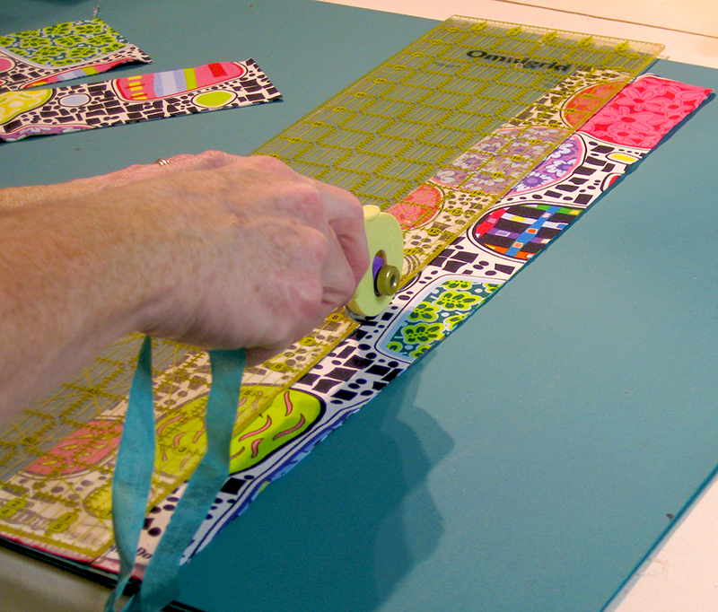 using-rotary-cutter-cut-strips-from-fabric-in-various-widths